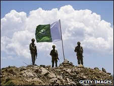 Pakistani soldiers stand guard on top of a mountain in the Swat valley on May 22, 2