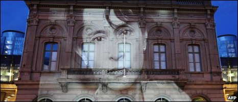 An image of Suu Kyi on a European building