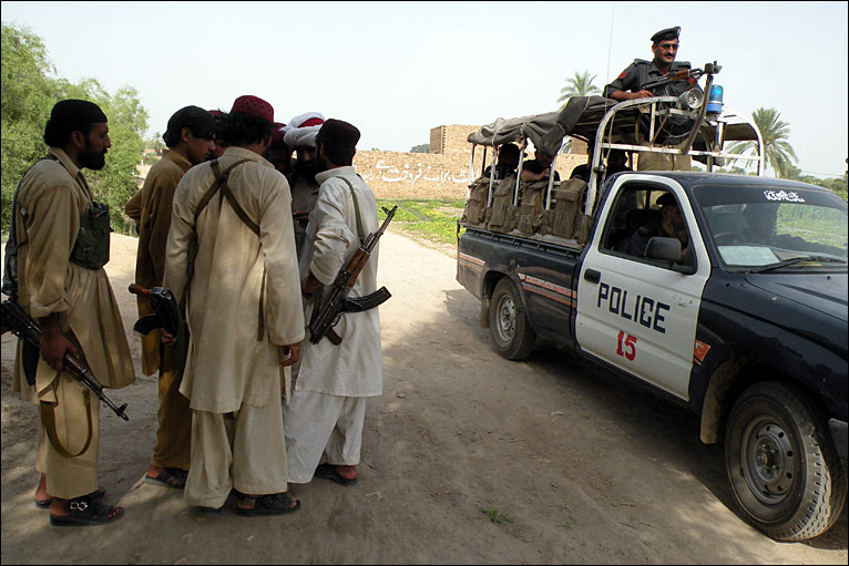Militants stand by a patrol