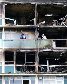 The gutted high rise block in Camberwell were the design was supposed to contain fires within each unit