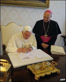 Pope Benedict XVI signs his encyclical Caritas in Veritate