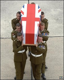 British soldiers carry the coffin of a comrade, 10 July