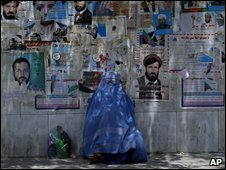 Woman and election posters, Jalalabad, 22 July, 2009