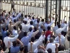 Photo released by Iranian exile group PMOI allegedly shows residents of its exile camp in Iraq protesting