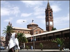 A woman crosses a street adjacent to the Cathedral and Catholic Mission compound in Asmara in 2007
