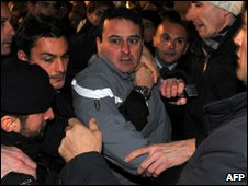 Alleged attacker Massimo Tartaglia being detained at the scene