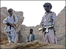Pakistani armed Bugti tribals keep vigil at the conflict area in the town of Dera Bugti in Pakistan's volatile southwestern Baluchistan province, 23 January 2006.