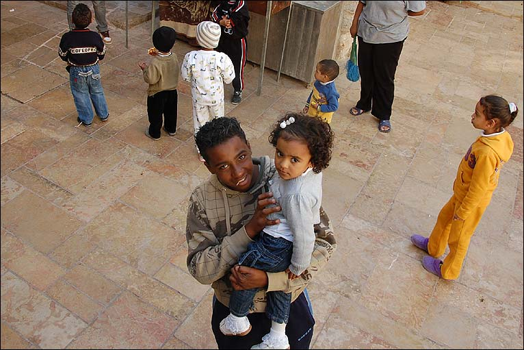 Youth with young child, African Quarter, Jerusalem Old City