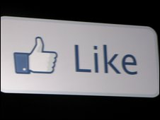 the world like and a thumbs up icon