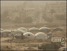 Lorries wait to load goods from the tent-covered smuggling tunnels in Rafah. Photo: April 2010