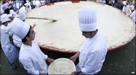 Lebanese chefs prepare a massive bowl of hummus in Fanar, east of Beirut