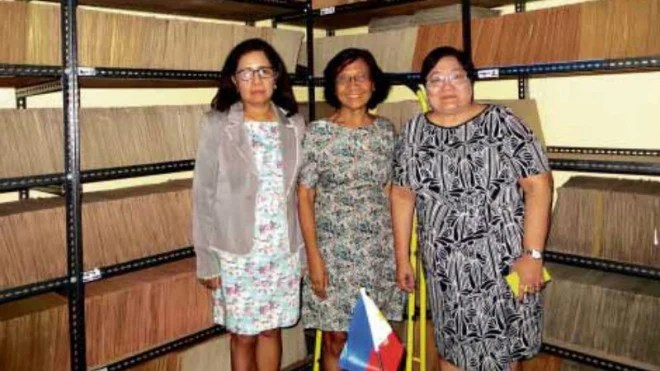 STAGGERING JOB Tens of thousands of case files line the walls of the offices of the Human Rights Victims Claims Board awaiting resolution, amonumental job for board chief Lina Sarmiento and members Aurora Parong and Erlinda Senturias. MA. CERES P. DOYO