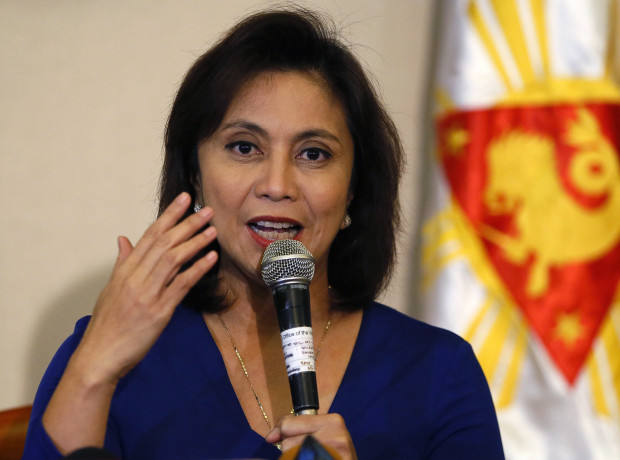 """FILE - In this Dec. 5, 2016 file photo, Philippine Vice President Leni Robredo answers questions from the media during a news conference following her resignation from her cabinet post under President Rodrigo Duterte in suburban Quezon city, south of Manila, Philippines. The Philippine vice president has raised alarms over the president's bloody crackdown against illegal drugs, which she says can't be solved """"with bullets alone,"""" and she also asked Filipinos to """"defy brazen incursions on their rights."""" The comments are one of Robredo's sharpest critiques so far of President Rodrigo Duterte's campaign and are likely to antagonize him because they are intended for an international forum of human rights advocates, whom he has often lambasted. (AP Photo/Bullit Marquez, File)"""