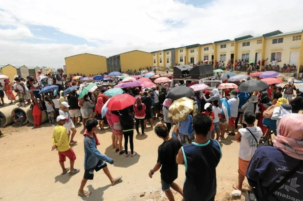 Settlers gather at the Atlantica housing project in Pandi town, Bulacan province, to get updates from their leaders on the status of their stay in the government-owned site.  —JOAN BONDOC