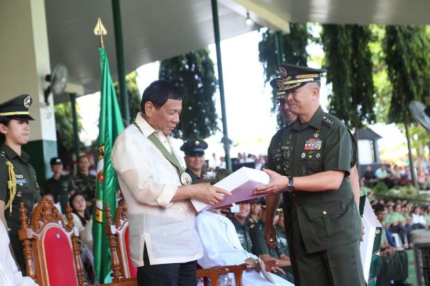 The Philippine Army gifts President Rodrigo Duterte a set of Army battle dress uniform and a canteen cup that symbolizes his support to the troops./OACPA