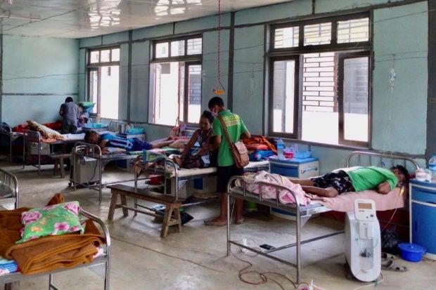 Coronavirus disease (COVID-19) patients receive treatment at the hospital in Cikha, Myanmar, May 28, 2021. REUTERS/Stringer