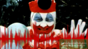 John Wayne Gacy in clown makeup and costume.