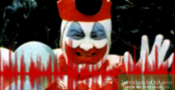 John Wayne Gacy in clown makeup and costume.