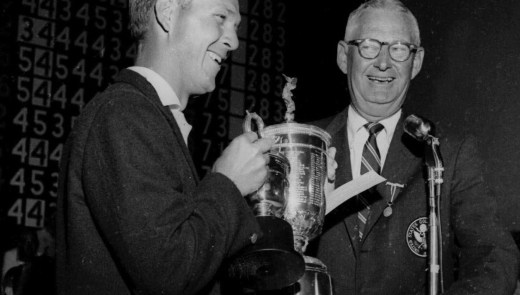 John Clock, president of the USGA, presents the U.S. Open trophy to Arnold Palmer, left, at the Cherry Hills Country Club in Denver in 1960. (Associated Press file)