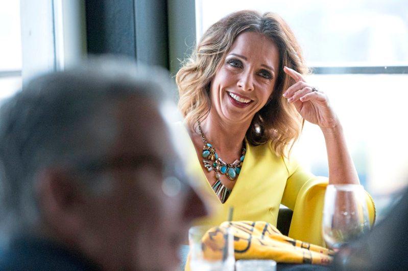 Stephanie McKinney Bucciero laughs during Mark Flaherty and Mary McKinney's wedding on Sunday, Oct. 23, 2017 at Monterey Bay Fish Grotto in Mount Washington. (Antonella Crescimbeni/Post-Gazette).