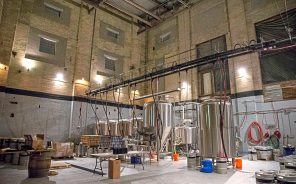 Hitchhiker Brewing Co. is located in a smokestack-topped former coal-fired boiler room and machine shop of the former Fort Pitt Brewing Co. in Sharpsburg. (Antonella Crescimbeni/Post-Gazette)