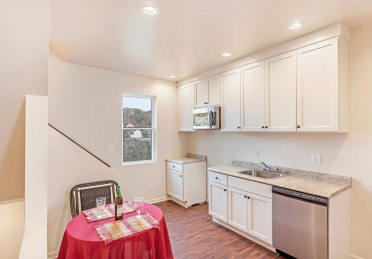 The kitchen at 524 Stanton Ave. in Millvale features new cabinets and flooring. (Gene Yuger/Pittsburgh Real Estate Media)