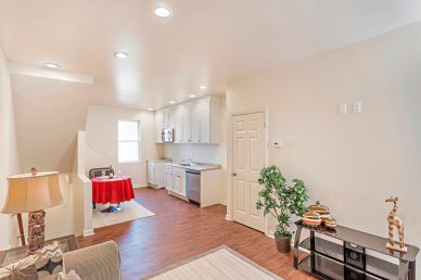 The combined living space at 524 Stanton Ave. in Millvale is open with recessed lighting and a small dining area. (Gene Yuger/Pittsburgh Real Estate Media)