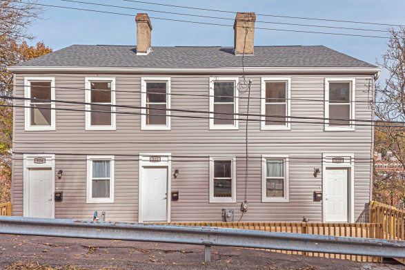 These three row houses at 520-524 Stanton Ave are the first new/construction rehabs in Millvale in more than a decade. (Gene Yuger/Pittsburgh Real Estate Media)