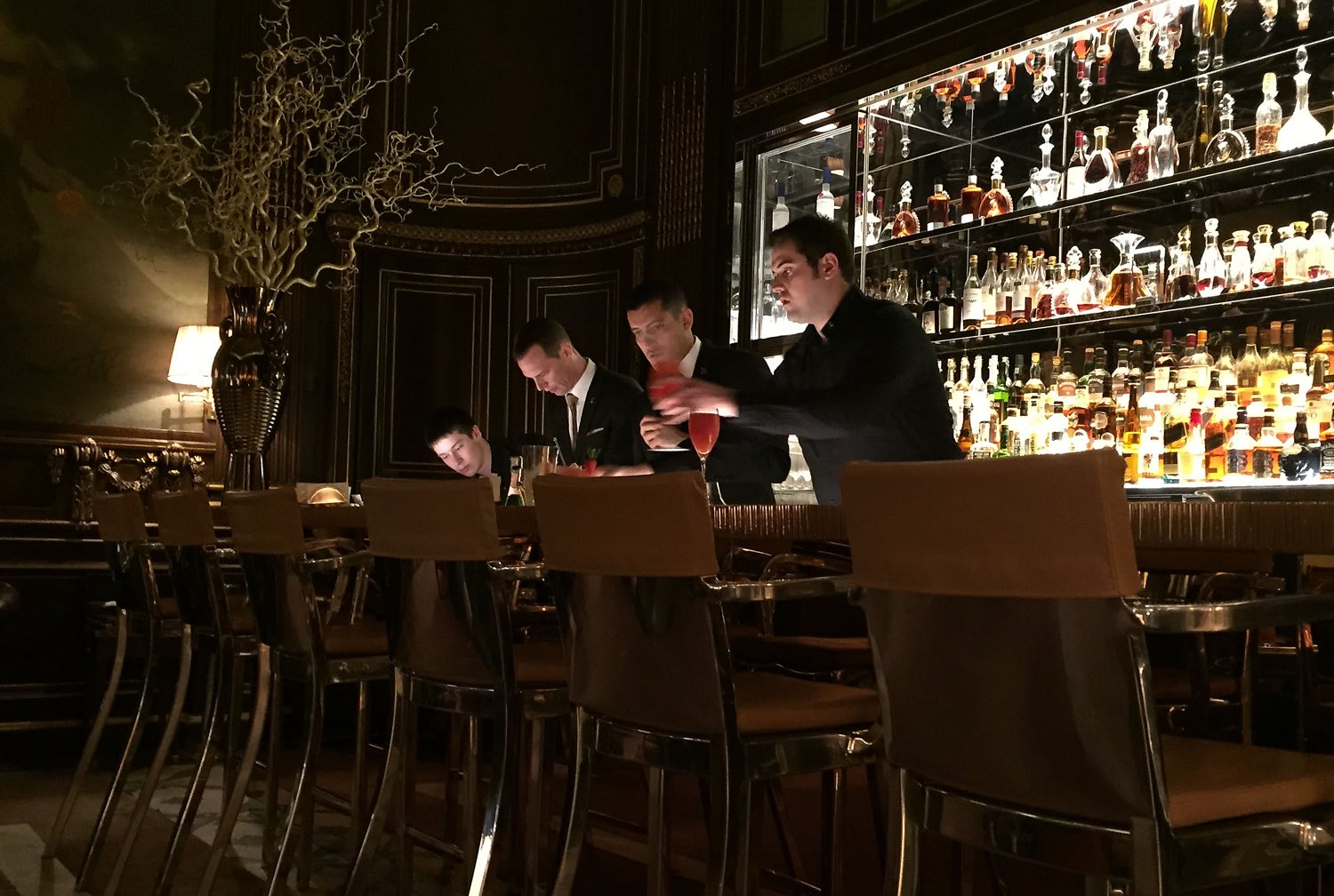 Bartenders at the five star Le Meurice Hotel in Paris mixing up drinks for thirsty customers. (Patricia Sheridan/Post-Gazette)