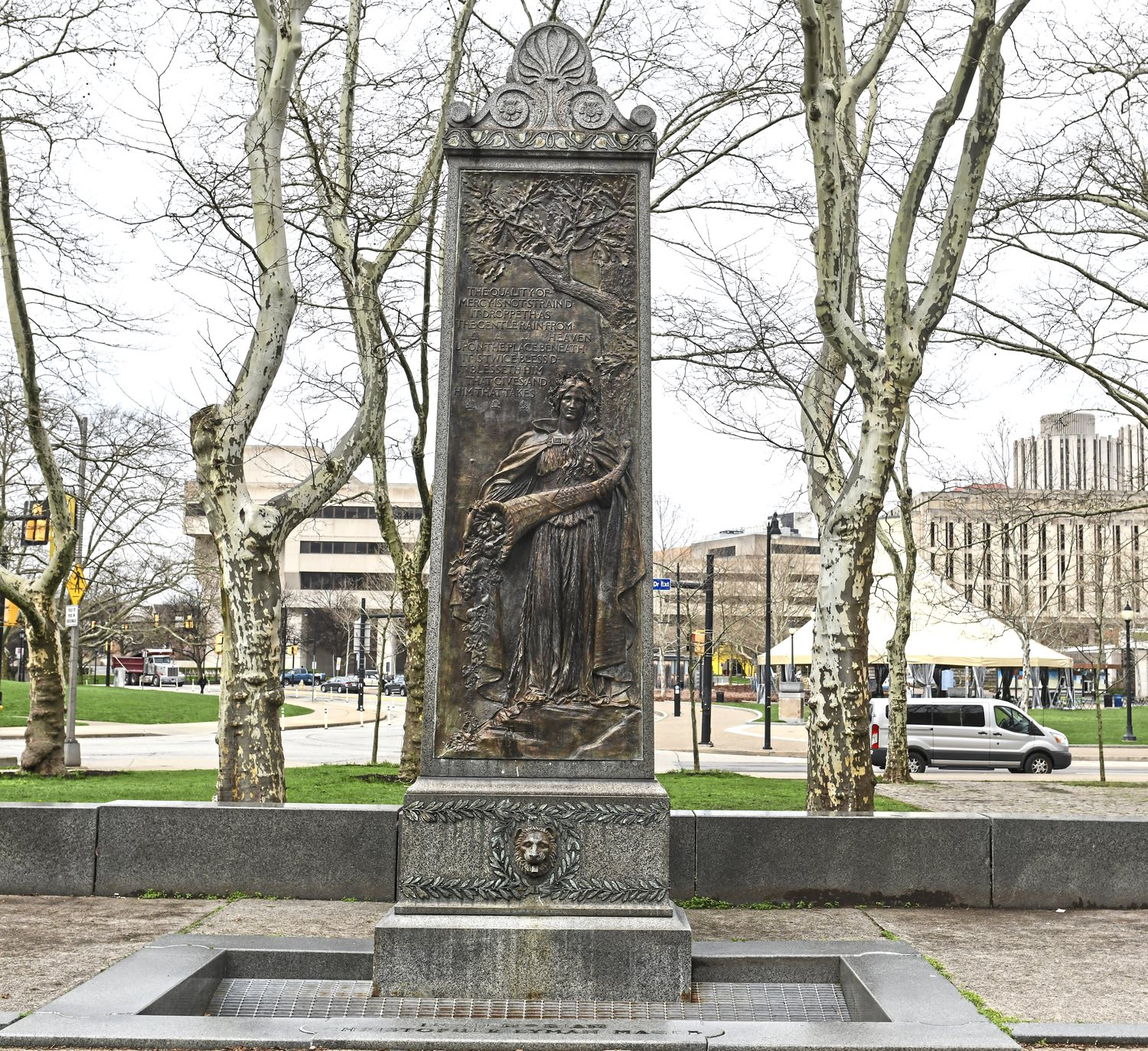 A view of a statute created by Augustus Saint-Gaudens. The piece, known as the Christopher Lyman Magee memorial, has a drinking fountain at its base. The statute is outside the Carnegie Library in Oakland. (Nate Guidry/Post-Gazette)