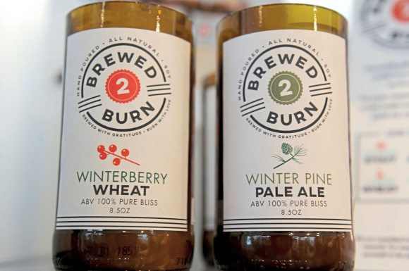 """Pittsburgh-based Brewed 2 Burn, """"hand poured beer inspired candles,"""" at Whimsy on Fifth on Fifth Avenue in Oakland. (Pam Panchak/Post-Gazette)"""