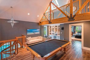 The second floor game room off one of the bedroom and loft with exposed wood beams at 5228 Westminster road, Shadyside. (Howard Hanna Real Estate)