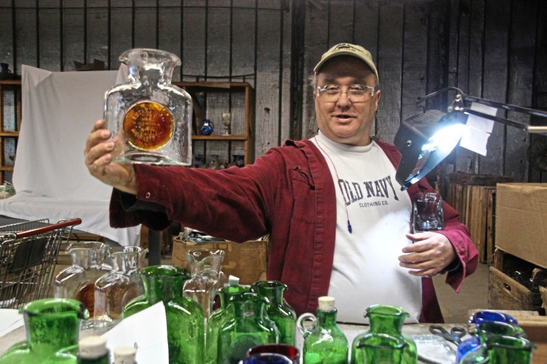 The popular rectangular water pitcher gets a custom medallion for a client. (Patricia Sheridan/Post-Gazette)