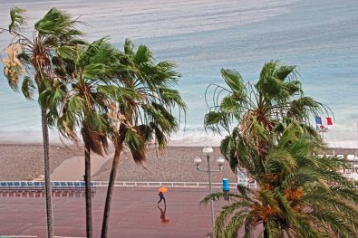 A rare rainy day in Nice, France as woman walks the Promenade des Anglais. (Patricia Sheridan)