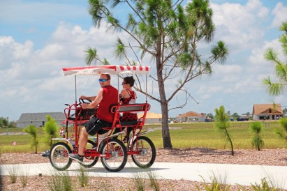 Distinction Residents of America's first solar town, Babcock Ranch, use peddle power to get around. credit Patricia Sheridan