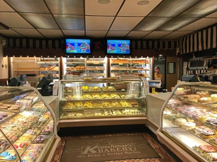 The fully-stocked bakery cases at Kretchmar's Bakery offer cakes, pies, doughnuts, pastries, breads. In sum, you name it. (Karen Kane/Post-Gazette)