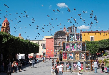 Distinction A flock of pigeons fly over the Pyramid of the Dead by artist Tomas Kurkey in San Miguel de Allende, Mexico. credit Patricia Sheridan