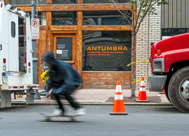"A skateboarder rides past the 707 Penn Gallery on Wednesday, Oct. 24 , 2018, in Downtown. The gallery is currently housing Pittsburgh artist Keny Marshall's exhibition ""Antumbra"". (Andrew Stein/Post-Gazette)"