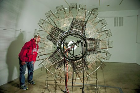 "Sam Chodosh of Squirrel Hill, checks out Pittsburgh artist Keny Marshall's exhibition ""Antumbra"" at the 707 Penn Gallery on Wednesday, Oct. 24 , 2018, in Downtown. Marshall is known for his kinetic and sculptural works. (Andrew Stein/Post-Gazette)"