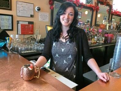 Kim Gardner of the Modern Cafe on the North Side with the Apple Cider Mule. (Bob Batz Jr./Post-Gazette)