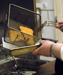 Hot filets out of the cooking oil. The New Alexandria VFD holds its annual fish fry as a fund raiser for the department. (Post-Gazette)