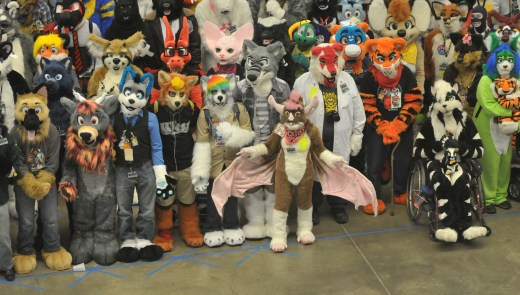 """""""Furries"""" pose for a group photo at the 2014 Anthrocon Annual Convention at the David L. Lawrence Convention Center in downtown Pittsburgh, PA. (Tony Tye/Post-Gazette)"""