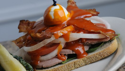 Max's Allegheny Tavern open Bavarian Club sandwich with rye bread, Milwaukee braunschweiger, bacon, sweet onion, tomato spinach & topped with an egg and secret sauce. (Pam Panchak / Post-Gazette )