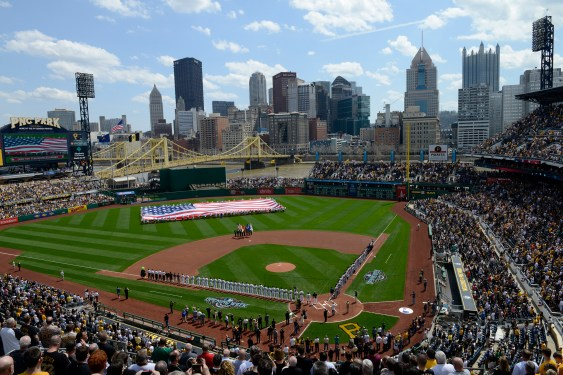 A flag is unfurled by season ticket holders on the field during the singing of the National Anthem during the Pirates home opener against the Detroit Tigers at PNC Park on the North Side Monday, April 13, 2015. (Rebecca Droke/Post-Gazette)