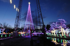 """Workers are testing the light display in advance of """"Holiday Lights"""" at Kennywood park which opens this Friday night, Nov. 27. This is Kennywood's 5th season of Christmas lights with 1.5 million lights and a new 90 foot tree all lit. The show runs Friday - Sunday weekends until Dec. 27th weather permitting (check their website) and closed Christmas. (John Heller/Post-Gazette)"""