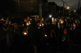 The mourners gathers for a candlelight vigil in honor of David McIntyre, 11, on Hays Avenue in Mt. Oliver on Tuesday, December 1, 2015. David was shot and killed and his brother CJ Mikula-Conrad, 16, was critically injured when a gunman enter their home and began shooting one month ago. Rebecca Droke/Post-Gazette