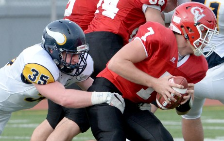 Central Catholic's David Adams pressures Cumberland Valley quarterback Joshua Ferguson. Matt Freed/Post-Gazette
