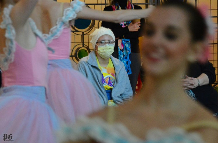 Lacey Pomaibo, 13, of New Stanton, watches as Pittsburgh Ballet Theatre pre-professional dancers perform Nutcracker excerpts at Children's Hospital of Pittsburgh of UPMC in Lawrenceville on Tuesday,  December 15, 2015. (Lake Fong/Post-Gazette )