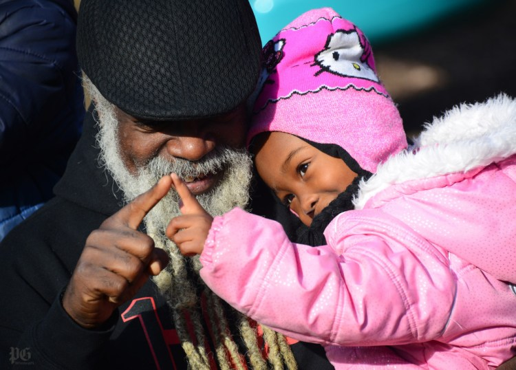 Paradise Gray with his adoptive daughter Harmonii Gray at West Park on Wednesday,  December 16, 2015. (Lake Fong/Post-Gazette)