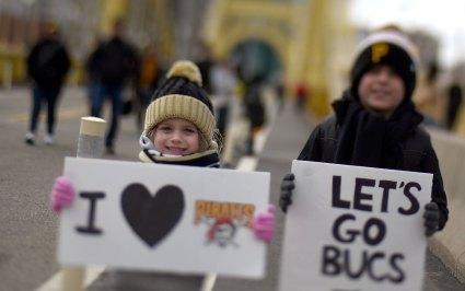 Alyson Gresh, 5, and brother Luke, 7, brought signs. (Steve Mellon/Post-Gazette)